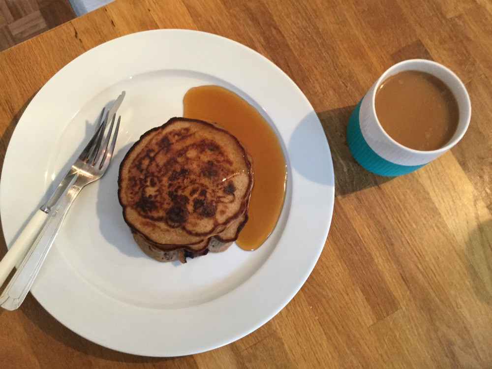 Buckwheat pancakes with coffee and syrup